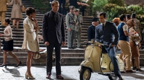 Alicia Vikander as Gabby Teller, Armie Hammer as Illya Kuryakin, and Henry Cavil as Napoleon Solo.